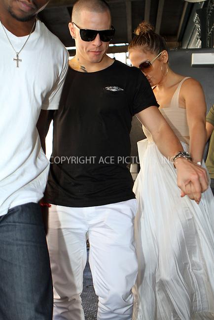 WWW.ACEPIXS.COM....July 24 2012, New York City....Jennifer Lopez and Casper Smart leave a downtown hotel on July 24 2012 in New York City....By Line: Nancy Rivera/ACE Pictures....tel: 646 769 0430..Email: info@acepixs.com..www.acepixs.com