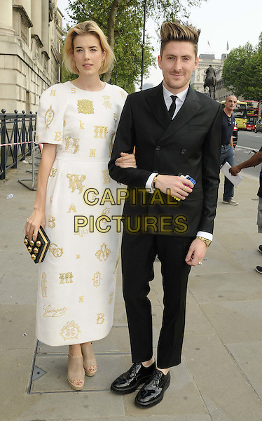 Agyness Deyn & Henry Holland.The NSPCC Pop Art Ball, Banqqueting House, Whitehall, London, England..May 24th, 2012.full length white dress black suit gold print .CAP/CAN.©Can Nguyen/Capital Pictures.
