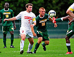 12 September 2010: Cornell University Big Red midfielder Jimmy Lannon (7), a Junior from Tinton Falls, NJ, battles University of Vermont Catamount midfielder Kyle Luetkehans, a Senior from LaGrange, IL, at Centennial Field in Burlington, Vermont. The Catamounts edged out the Big Red 2-1. Mandatory Credit: Ed Wolfstein Photo