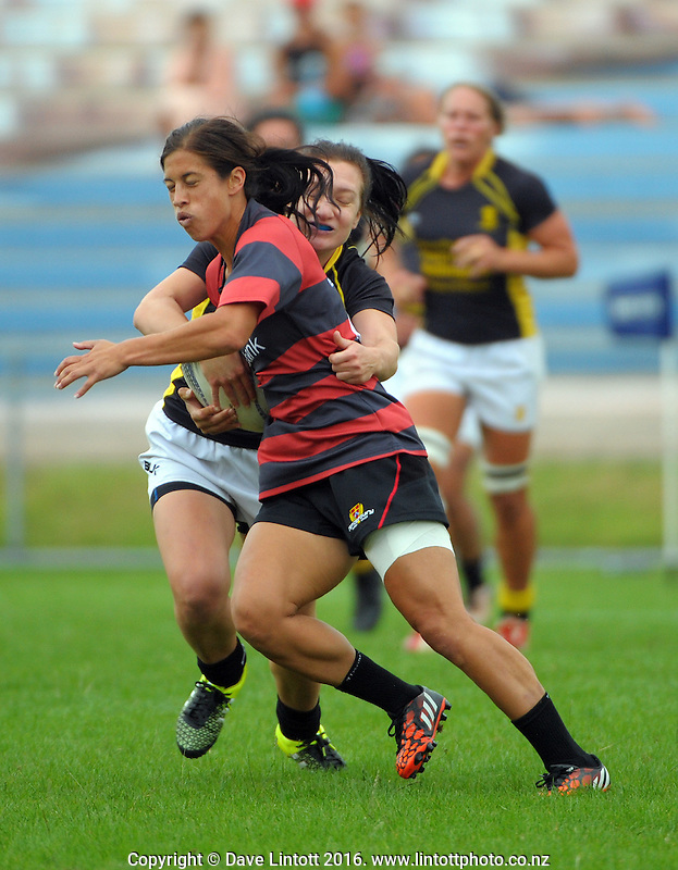 Wellington's Georgia Daals strips the ball from Keshia Grant during the women's semifinal match between Wellington and Canterbury on day two of the Bayleys National Sevens at Rotorua International Stadium, Rotorua, New Zealand on Sunday, 17 January 2015. Photo: Dave Lintott / lintottphoto.co.nz