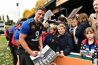 Rhys Priestland of Bath Rugby mingles and signs autographs with supporters at the end of the session. Bath Rugby Captain's Run on October 30, 2015 at the Recreation Ground in Bath, England. Photo by: Patrick Khachfe / Onside Images