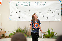 Lauren Breynaert '16 talks to students while looking up at the AGC building. Occidental College students march in a rally organized by Fossil Free Occidental on Nov. 14, 2014. The group hopes to end Oxy's reliance on fossil fuels by freezing all investments in the 200 largest fossil-fuel companies (measured by their proven carbon reserves in oil, gas or coal) and over the next five to ten years sell the stock in these same companies, and then reinvest 5%, at minimum, of the divested portfolio in socially responsible investments. (Photo by Marc Campos, Occidental College Photographer)