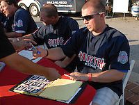 Robbie Ross of the Hickory Crawdads signs autographs at the 2010 South Atlantic League All-Star Game welcome party and festivities Monday night June 21, 2010, at the Wyche Pavilion along the Reedy River in Greenville, S.C. Photo by: Tom Priddy/Four Seam Images