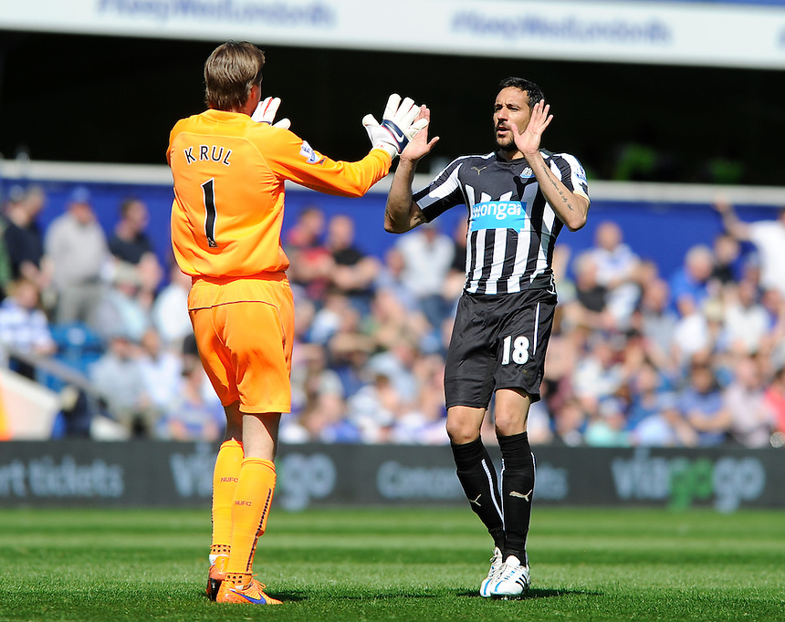 Newcastle United's Jonas Gutierrez (right) celebrates with Tim Krul after they take a 1-0 lead<br /> <br /> Photographer Ashley Western/CameraSport<br /> <br /> Football - Barclays Premiership - Queens Park Rangers v Newcastle United - Saturday 16th May 2015 - Loftus Road - London<br /> <br /> &copy; CameraSport - 43 Linden Ave. Countesthorpe. Leicester. England. LE8 5PG - Tel: +44 (0) 116 277 4147 - admin@camerasport.com - www.camerasport.com