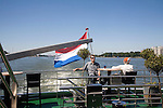 Tourists on a Spido tour boat on River Maas, Port of Rotterdam, Netherlands