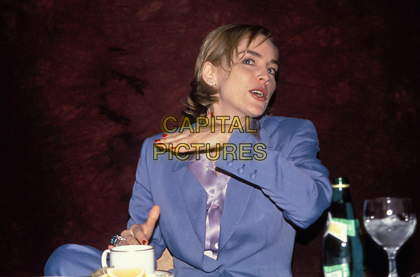 SHARON STONE.Ref: 048.half length hand arm blue.www.capitalpictures.com.sales@capitalpictures.com.©Capital Pictures.