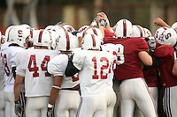 11 April 2007: Pat Maynor, Nick Sanchez, Derek Belch, Evan Moore and the team huddle during spring practice at the practice field in Stanford, CA.