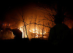 Waterbury, CT- 01 December 2016-123116CM10-  Waterbury firefighters battle a blaze at a former storage facility near the intersection of South Main Street and Pearl Lake Road in Waterbury on Saturday night.   Christopher Massa Republican-American