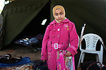 An Egyptian girl outside her tent a temporary shelter at the Tunisia-Libya border near Ben Guerdane, Tunisia, Friday, Feb. 25, 2011. Thousands crossed the border into Tunisia, fleeing the violence of an uprising in Libya. Opposition forces reportedly have control of much of the country, but Col. Muammar Qaddafi still controls the capital Tripoli.