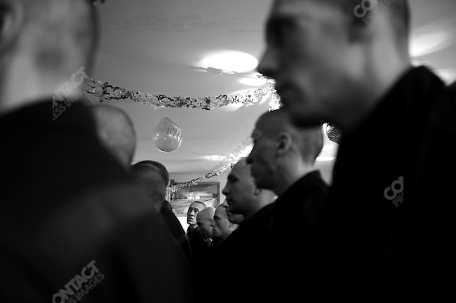 Prisoners, recently arrived at prison colony #7 outside of Novgorod in the Novgorod region south of St. Petersburg, Russia, paraded in their temporary lodgings before the prison's commander. December 15, 2008