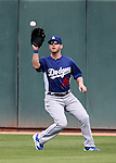 Dodgers outfielder Cory Sullivan makes a catch during a Cactus League preseason game between the Dodgers and the A's in Scottsdale, Ariz., on Wednesday, March 7, 2012. The game ended 3-3..Photo by Cathleen Allison