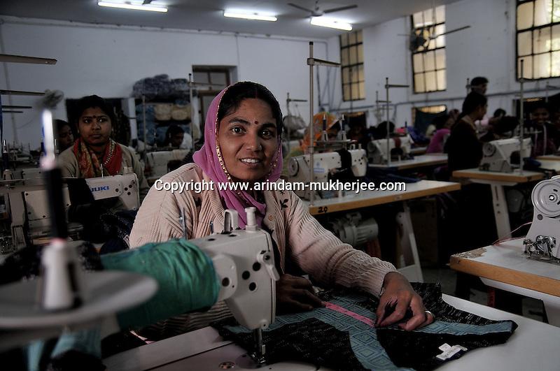 "Nehal Kumari, 35 years, works at the main workshop of ""Sadhana"" in Udaipur, Rajasthan, India. She is happy working here as she can help her husband financially from the money she earns. 24.1.2011. Arindam Mukherjee"