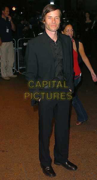 GUY PEARCE.The Times BFI London Film Festival: The Proposition - MTV gala.October 26th, 2005.Ref: CAN.full length black suit hands in pockets.www.capitalpictures.com.sales@capitalpictures.com.©Capital Pictures
