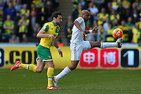 Russell Martin of Norwich City and Andre Ayew of Swansea City in action during the Barclays Premier League match between Swansea City and Norwich City played at The Liberty Stadium, Swansea on March 5th 2016
