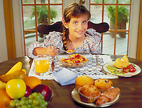 girl eating nutritious breakfast. Nutrition, Youth. child, children, food, muffins, juice, fruit, cereal, croissant.