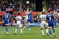 George Byers of Swansea City (C) fights for a header during the Sky Bet Championship match between Swansea City and Cardiff City at the Liberty Stadium, Swansea, Wales, UK. Sunday 27 October 2019