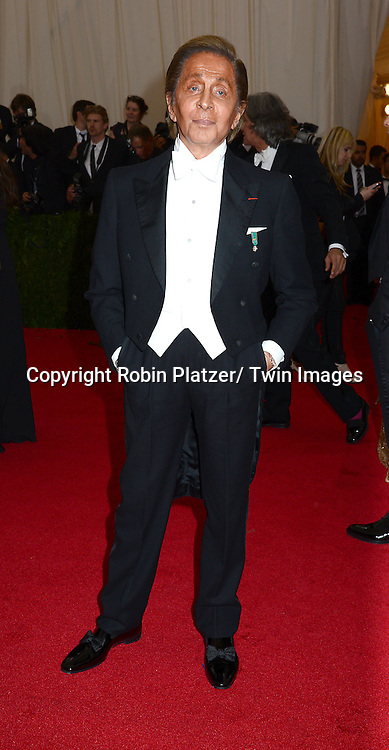 Valentino attends the Costume Institute Benefit on May 5, 2014 at the Metropolitan Museum of Art in New York City, NY, USA. The gala celebrated the opening of Charles James: Beyond Fashion and the new Anna Wintour Costume Center.
