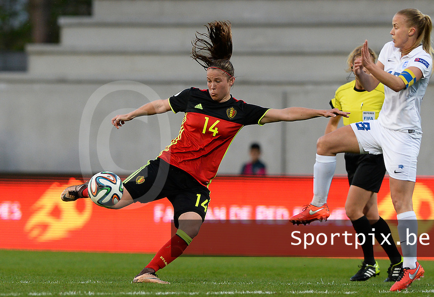 20160412 - LEUVEN ,  BELGIUM : Belgian Lenie Onzia (14) pictured shooting towards goal with defending Estonian Kethy Ounpuu (right)  during the female soccer game between the Belgian Red Flames and Estonia , the fifth game in the qualification for the European Championship in The Netherlands 2017  , Tuesday 12 th April 2016 at Stadion Den Dreef  in Leuven , Belgium. PHOTO SPORTPIX.BE / DAVID CATRY
