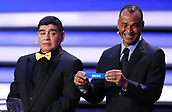 1st December 2017, State Kremlin Palace, Moscow, Russia;  Draw assistant Cafu (R) holds the draw for Sweden beside retired  player and draw assistant Diego Maradona (L) on stage during the FIFA 2018 World Cup draw, at the State Kremlin Palace in Moscow, Russia, 01 December 2017.