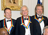 John Paul Jones, Jimmy Page and Robert Plant, of Led Zepplin, recipients of the 2012 Kennedy Center Honors, pose for a photo following a dinner hosted by United States Secretary of State Hillary Rodham Clinton at the U.S. Department of State in Washington, D.C. on Saturday, December 1, 2012.  The 2012 honorees are Buddy Guy, actor Dustin Hoffman, late-night host David Letterman, dancer Natalia Makarova, and the British rock band Led Zeppelin (Robert Plant, Jimmy Page, and John Paul Jones)..Credit: Ron Sachs / CNP