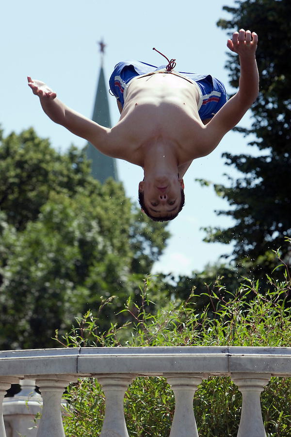 Moscow, Russia, 25/06/2010..A teenager summersaults into fountains next to the Kremlin and Red Square during a heatwave that has seen temperatures of up to 37C, a record for the month of June.