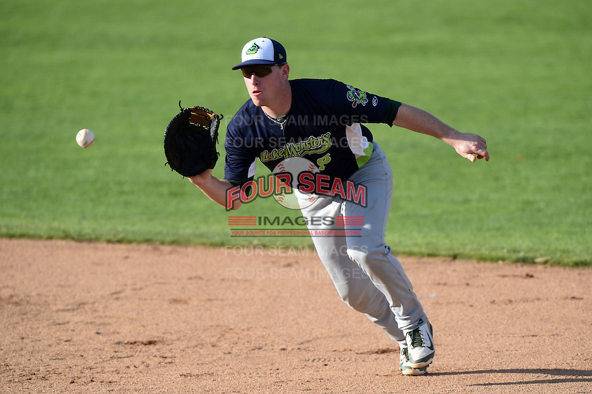 Vermont Lake Monsters first baseman John Nogowski (8) fields a ground ball during a game against the Jamestown Jammers on July 13, 2014 at Russell Diethrick Park in Jamestown, New York.  Jamestown defeated Vermont 6-2.  (Mike Janes/Four Seam Images)