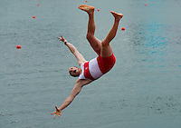 Canada's men's eight rowing team member Will Crothers flips himself into the water as he celebrates his silver medal at Eton Dorney during the 2012 Summer Olympics in Dorney, England on Wednesday, August 1, 2012. THE CANADIAN PRESS/Sean Kilpatrick