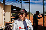 Bob Murray, 87, stands in the dug-out with his teammates during a softball game in Sun City, Arizona December 3, 2013. Sun City, Arizona was the first age-restricted city of retirees when it opened in 1960.