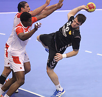 15.01.2013 Granollers, Spain. IHF men's world championship, prelimanary round. Picture show Vasko Sevaljevic   in action during game between Tunisia vs Montenegro at Palau d'esports de Granollers