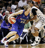 Detroit's Katie Smith (30) runs around San Antonio's Vickie Johnson (55) during Game 2 of the WNBA Finals between the Detroit Shock and the San Antonio Silver Stars, Oct. 3, 2008, at the AT&T Center in San Antonio. Detroit won 69 - 61 to go up 2 - 0 in the best-of-five series. (Darren Abate/pressphotointl.com)
