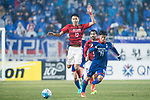 Suwon Midfielder Kim Minwoo (R) fights for the ball with Guangzhou Defender Wang Shangyuan (L) during the AFC Champions League 2017 Group G match Between Suwon Samsung Bluewings (KOR) vs Guangzhou Evergrande FC (CHN) at the Suwon World Cup Stadium on 01 March 2017 in Suwon, South Korea. Photo by Victor Fraile / Power Sport Images