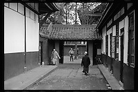 Chinese Buddhist monks walk through their dormitory at Wenshu Yuan, or God of Wisdom Temple, in Chengdu, capital city of the southwestern province of Sichuan, in March, 2011.