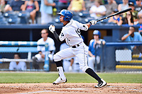 Asheville Tourists center fielder Manny Melendez (19) swings at a pitch during a game against the Greensboro Grasshoppers at McCormick Field on April 30, 2017 in Asheville, North Carolina. The Grasshoppers defeated the Tourists 7-0. (Tony Farlow/Four Seam Images)