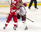 Evan Rodrigues (BU - 17), Pat Mullane (BC - 11) - The Boston College Eagles defeated the visiting Boston University Terriers 5-2 on Saturday, December 1, 2012, at Kelley Rink in Conte Forum in Chestnut Hill, Massachusetts.