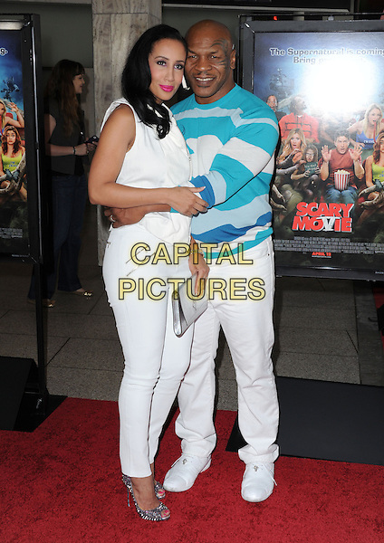 Lakiha Spicer & Mike Tyson .at The Dimension Films Premiere of 'Scary Movie 5' held at The Cinerama Dome in Hollywood, California, USA, April 11th 2013.                                                               .full length trousers arms around husband wife couple  tattoo on face blue white print jumper sweater clutch bag silver top jeans .CAP/DVS.©Debbie VanStory/Capital Pictures