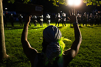 A protestor holds their hands in the air as police and National Guard look on during a protest in Lafayette Square in Washington, D.C., U.S., on Sunday, May 31, 2020, following the death of an unarmed black man at the hands of Minnesota police on May 25, 2020.  Credit: Stefani Reynolds / CNP/AdMedia