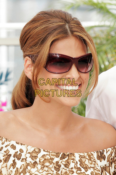 "EVA MENDES.Photocall for ""We Own the Night "" during the 60th International Cannes Film Festival, Cannes, France. .May 25th, 2007.headshot portrait mendez sunglasses shades.CAP/DAR.©Darwin/Capital Pictures"