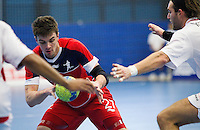08 JAN 2012 - LONDON, GBR - Great Britain left wing John Pearce (#27, in red) looks for a way through the Austrian defence during the men's 2013 World Handball Championships qualification match at the National Sports Centre in Crystal Palace, Great Britain .(PHOTO (C) 2012 NIGEL FARROW)