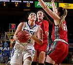 BROOKINGS, SD - JANUARY 25: Ellie Thompson #45 from South Dakota State University drives to the basket against Ciara Duffy #24 from the University of South Dakota during their game Thursday night at Frost Arena in Brookings. (Photo by Dave Eggen/Inertia)
