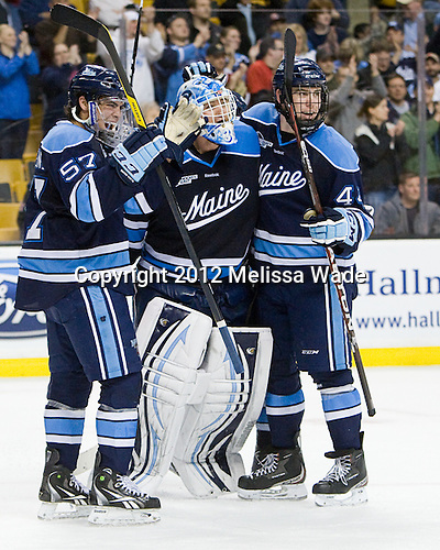 Matt Mangene (Maine - 57) and Ryan Hegarty (Maine - 44) were the first to reach Dan Sullivan (Maine - 30) to celebrate the win. - The University of Maine Black Bears defeated the Boston University Terriers in their Hockey East semi-final 5-3 (EN) on Friday, March 16, 2012, at TD Garden in Boston, Massachusetts.