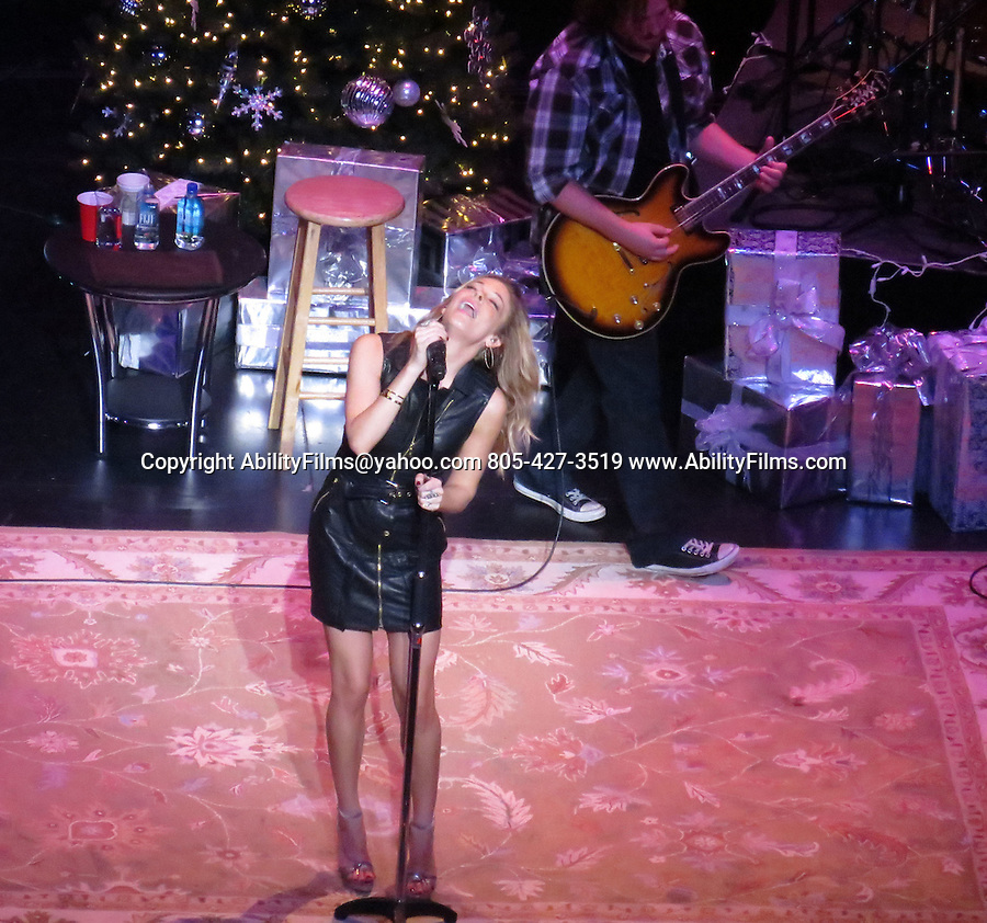 December 5th 2012  Exclusive <br /> <br /> LeAnn Rimes singing &amp; performing at the Civic Arts plaza in Thousand Oaks California.  LeAnn took off her shoes and sat down on stage to finish off her show after complaining about how dancing in high heels really huts.  Barefoot is much better. <br /> LeAnn was performing very close to home so her mom and husband also were at  the show. LeAnn was wearing a tight black leather dress skirt <br /> <br /> AbilityFilms@yahoo.com<br /> 805-427-3519<br /> www.AbilityFilms.com
