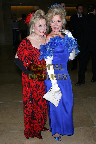 CAROL CONNERS & DEANNA LUND.The John Wayne Cancer Institute Auxiliary 21st Annual Odyssey Ball held at the Beverly Hilton Hotel, Beverly Hills, California, USA, 8th April 2006..full length fashion disaster red blue dress feathers boa.Ref: ADM/ZL.www.capitalpictures.com.sales@capitalpictures.com.©Zach Lipp/AdMedia/Capital Pictures.