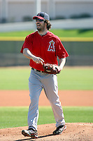 Dan Haren #24 of the Los Angeles Angels participates in pitchers fielding practice during spring training workouts at the Angels complex on February 16, 2011  in Tempe, Arizona. .Photo by:  Bill Mitchell/Four Seam Images.