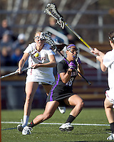 University at Albany midfielder Allie Phelan (18) loses the ball in traffic. University at Albany defeated Boston College, 11-10, at Newton Campus Field, on March 30, 2011.