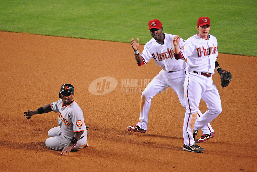 Apr. 21, 2008; Phoenix, AZ, USA; Arizona Diamondbacks shortstop Stephen Drew (right) and Orlando Hudson (center) celebrate after completing a double play after forcing out San Francisco Giants base runner Ray Durham in the seventh inning at Chase Field. Mandatory Credit: Mark J. Rebilas-