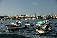 The Golden Horn, Istanbul, Turkey with the skyscrapers of Mecidiyekoy in the background
