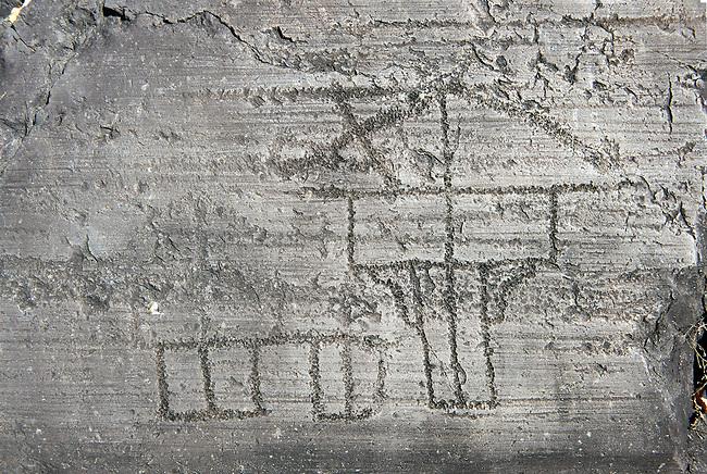Petroglyph, rock carving, of a house on stilts. Carved by the ancient Camunni people in the iron age between 1000-1200 BC. Rock no 24, Foppi di Nadro, Riserva Naturale Incisioni Rupestri di Ceto, Cimbergo e Paspardo, Capo di Ponti, Valcamonica (Val Camonica), Lombardy plain, Italy