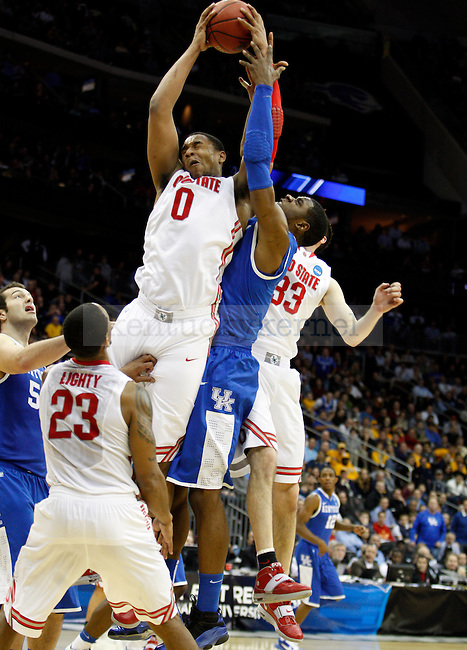 Terrence Jones fights Jared Sullinger for a rebound in the second half of UK's Sweet 16 NCAA tournament win, 62-60 against 1 seed Ohio State at the Prudential Center in Newark, New Jersey on Friday, March 25, 2011.  Photo by Britney McIntosh | Staff