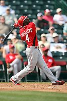 Brandon Phillips #4 of the Cincinnati Reds bats against the Los Angeles Angels in a spring training game at Tempe Diablo Stadium on March 1, 2011  in Tempe, Arizona. .Photo by:  Bill Mitchell/Four Seam Images.