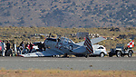 Pilot Kevin Sutterfield had a landing gear collapse on the runway of his T-6 plane Honest Entry during the National Championship Air Races at the Reno-Stead Airfield Friday, Sept. 18, 2015.